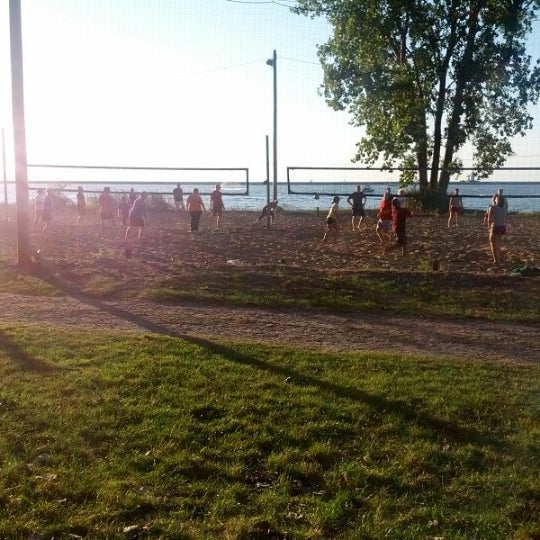 Photo taken at Whiskey Island Volleyball Courts by Anthony M. on 7/11/2012