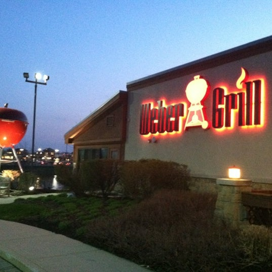 Photo taken at Weber Grill Restaurant by Nick P. on 3/22/2012