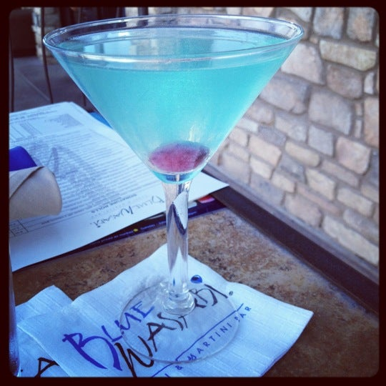 Photo taken at Blue Wasabi Sushi & Martini Bar by Devon K. on 8/4/2012