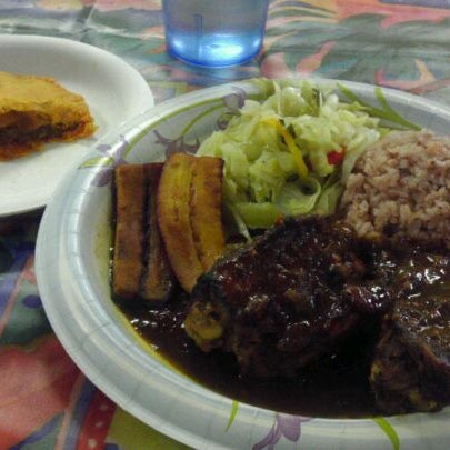 Photo taken at Mama Jamaica's Kitchen by Anh H. on 2/14/2012