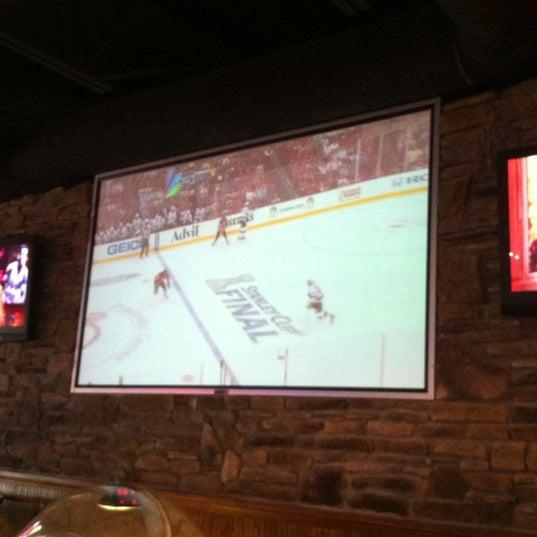 Photo taken at Sak's Sports Bar by Laura M. on 5/31/2012