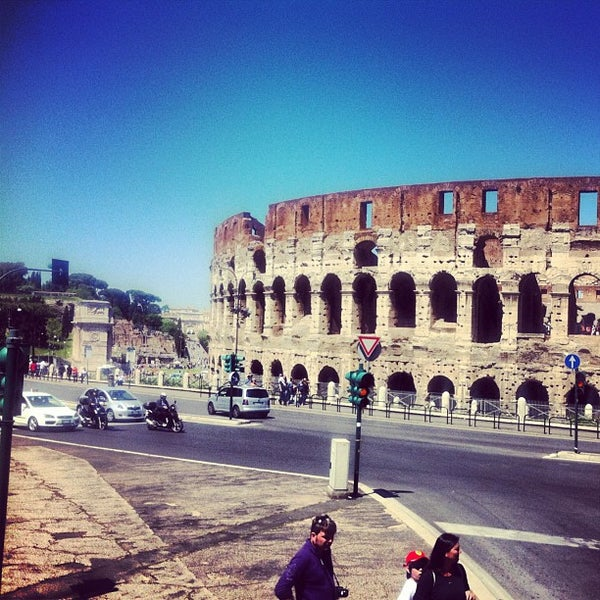 Photo taken at Piazza del Colosseo by Maria on 5/3/2012