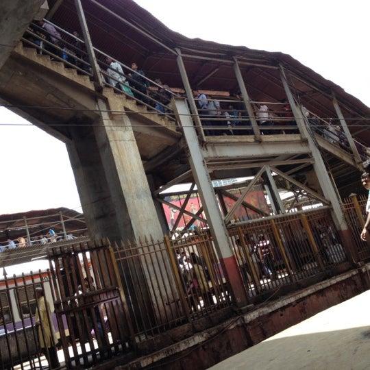 Photo taken at Dadar Railway Station by Mandar R. on 6/16/2012