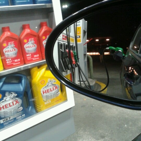 Photo taken at Shell by Cristian O. on 7/12/2012