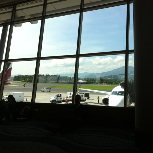 Photo taken at Gate 5 Aeropuerto Internacional Juan Santamaria by Rolando T. on 6/2/2012
