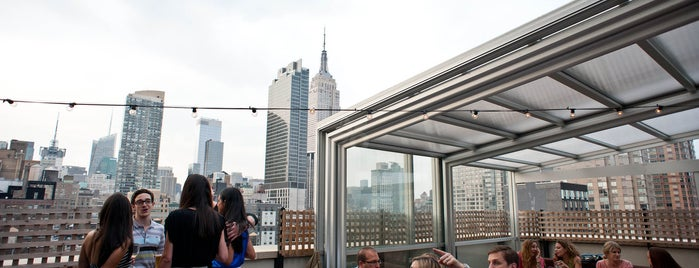 Hilton New York Fashion District is one of The Best Hotel Rooftops in NYC.