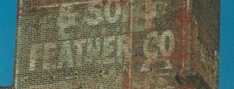 Peter Woll & Sons Feather Co. Ghost Sign is one of Ghost Signs and Faded Ads.