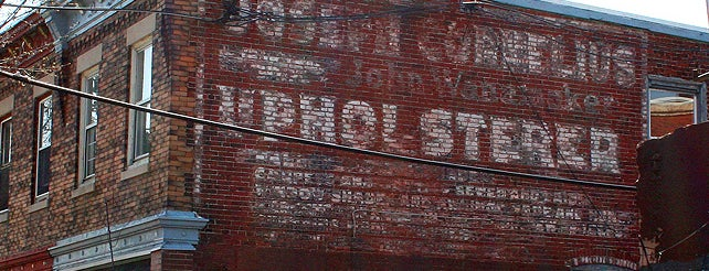 Joseph Cornelius Upholsterer Ghost Sign is one of Ghost Signs and Faded Ads.