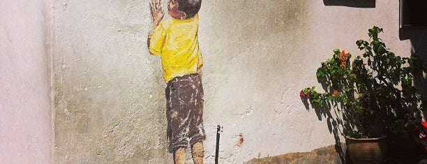 Penang Street Art : Boy on Chair is one of Penang Art.