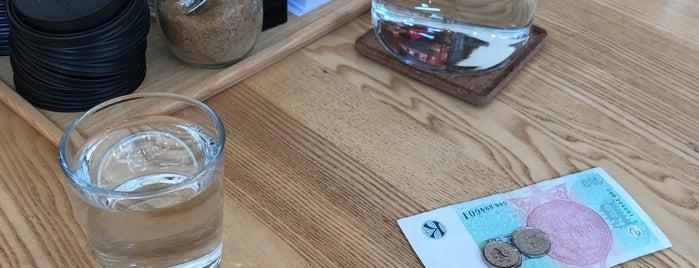 Monogram Espresso Bar is one of Cafés.